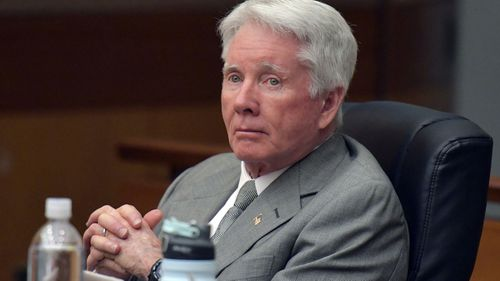 "Claud ""Tex"" McIver sits with his defence team during his trial. (AAP)"