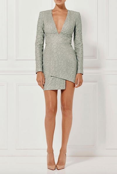 Perfectly suited to a springtime wedding or ladies&rsquo; day at the races, this sexy-but-sweet frock&rsquo;s spliced hemline and lightly shimmering, textured print is a winner.<br />