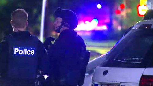 Police arrest man after alleged armed stand-off in Melbourne home while children slept