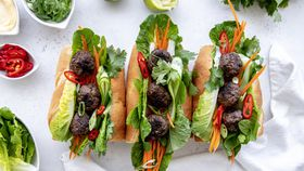 Charred veal meatballs served in a banh mi recipe
