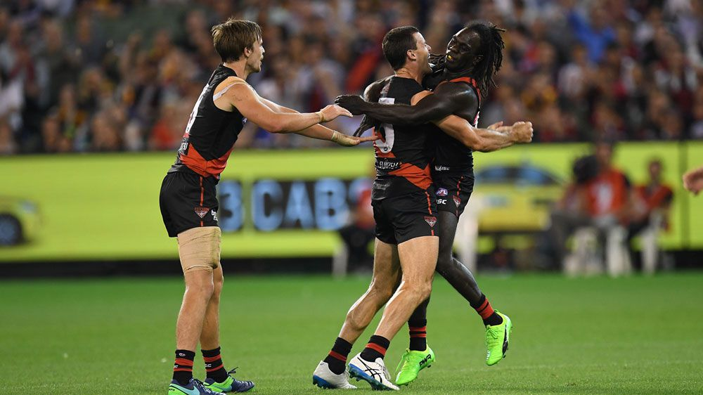 Bombers players celebrate during their win over Hawthorn