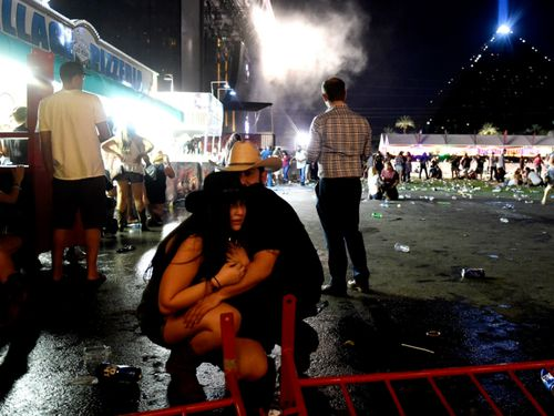 Country music fans struggle to take in what has just happened on a Sunday night in Vegas.