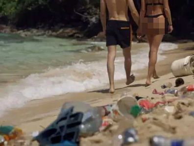 Pornhub 'Dirtiest Porn Ever': couple walking along a beach covered in rubbish