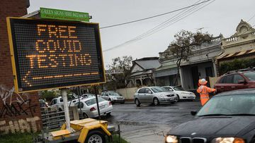 Cars enter a drive through COVID testing site in Brunswick in Melbourne.