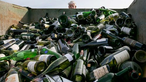 More than 500 bottles of counterfeit and unsellable wine are destroyed at the Texas Disposal Systems recycling and compost facility in Austin, Texas. The wine is from the Rudy Kurniawan case.