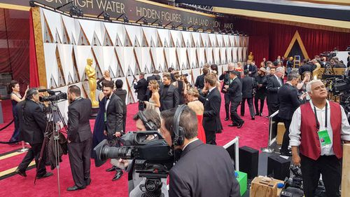 The media makes preparations ahead of the Red Carpet kick-off. (9NEWS/Ehsan Knopf)