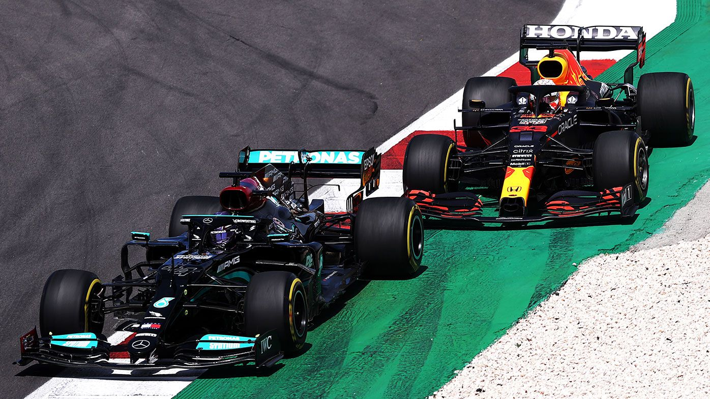 Max Verstappen goes off track in his battle with Lewis Hamilton at the Portuguese Grand Prix.