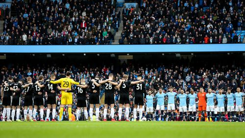Manchester City and Burnley players stand for a minutes silence in memory of Emiliano Sala during the Emirates FA Cup Fourth Round match at the Etihad Stadium.