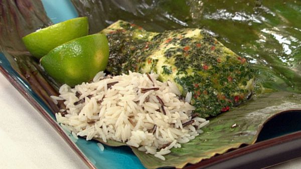 Fish in banana leaves with chimichurra sauce