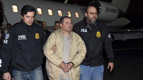 Joaquin Guzman, or El Chapo, is escorted off a plane.