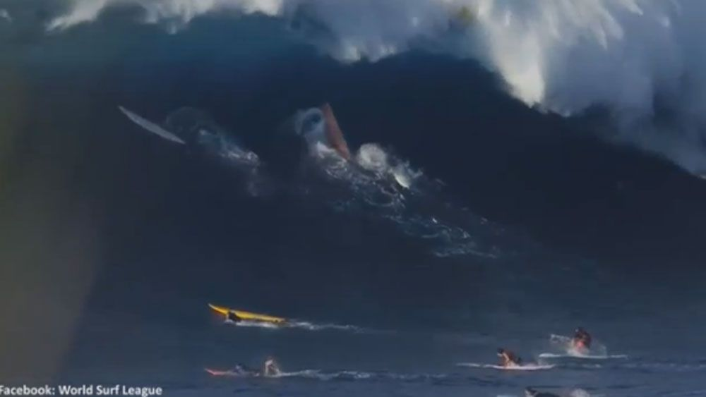 Surfers scurry like ants as monster wave bears down