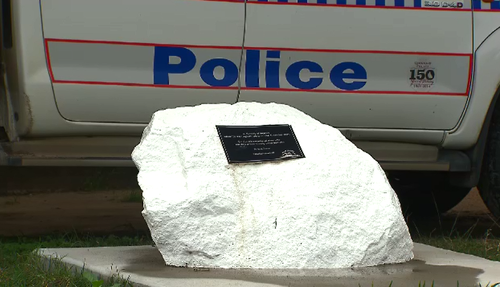 A large white rock outside the police station still sits as a memorial to Mulrunk Doomagee - a reminder that the people of Palm Island will not forget. (9NEWS)
