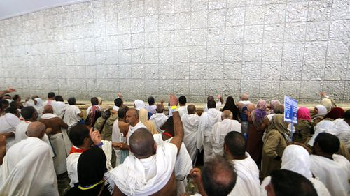 Muslim pilgrims take part in the symbolic stoning of the devil at the Jamarat Bridge in Mina. (AFP)
