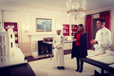 "<p>Melania Trump has a wardrobe full of luxury coats from the likes of Balmain, Max Mara and Escada. Yet the US First Lady seems to ignore the sleeves they come with.</p> <p>The former model is routinely seen draping her designer garb over her shoulders, a look favoured by fashion insiders and editors, known as 'coat-slinging'.</p> <p>Earlier this week, the 47-year-old ignited  a social media firestorm when she posted a photo to <a href=""https://www.instagram.com/flotus/"" target=""_blank"" draggable=""false"">Instagram</a> of herself tending to White House Christmas decorations.</p> <p>In the snap FLOTUS can be seen wearing a $2000 plaid coat from Calvin Klein, or rather not wearing it.</p> <p>""Why does Melania always have to walk around with a jacket on her shoulders? Like put it on or take it off,"" one user wrote.</p> <p>""Why don't you actually WEAR your coat instead of draping it. You're #NOTBatman !"" another wrote.</p> <p>Trump's inclination for draping may have divided the internet but for us this is one sartorial look that we think deserves some right royal praise. </p> <p>Click through to see how Melania Trump has brought coat-slinging back in Vogue.</p>"