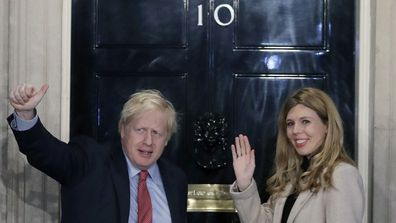 Friday, Dec. 13, 2019 file photo, Britain's Prime Minister Boris Johnson and his partner Carrie Symonds wave from the steps of number 10 Downing Street in London