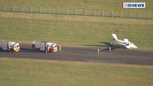 Emergency crews met the plane on the tarmac. (9NEWS)