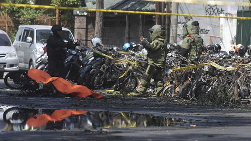 The family drove a car and motorbikes into churches, which then exploded - killing at least 13 people and injuring more than 40 others. Picture: AAP.