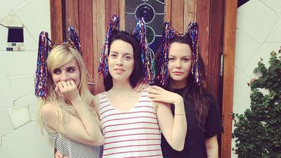 Emma Roberts is spending the day with friends, donning some celebratory headgear. (Instagram)