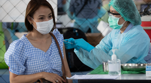 A health worker administers a dose of the Sinovac COVID-19 vaccine to a person working at an entertainment venue where a new cluster of COVID-19 infections was found, in Bangkok, Thailand, Wednesday, April 7, 2021.
