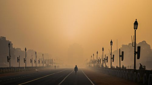 A man walked along Rajpath boulevard amid smoggy conditions in New Delhi, India.