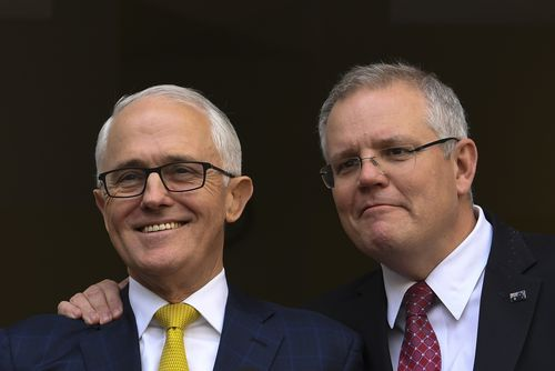 Loyal to the end, Scott Morrison stood shoulder to shoulder with outgoing PM Malcolm Turnbull on Wednesday.
