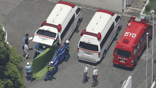 An aerial photo shows ambulances taking students to a hospital due to suspicion of heatstroke at Oizumisakura high school in Nerima Ward, Tokyo. Picture: AAP