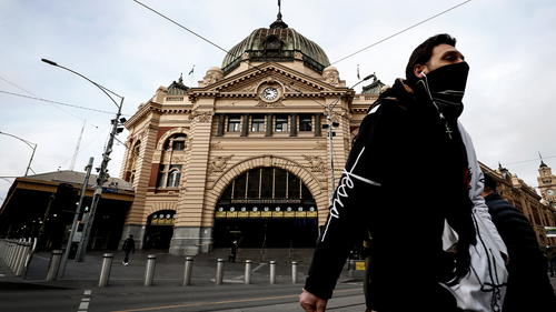 A man is seen wearing a face mask out Flinders Street Station on July 23, 2020 in Melbourne, Australia. Face masks or face coverings are now mandatory for anyone leaving their homes in the Melbourne metropolitan area or the Mitchell Shire.