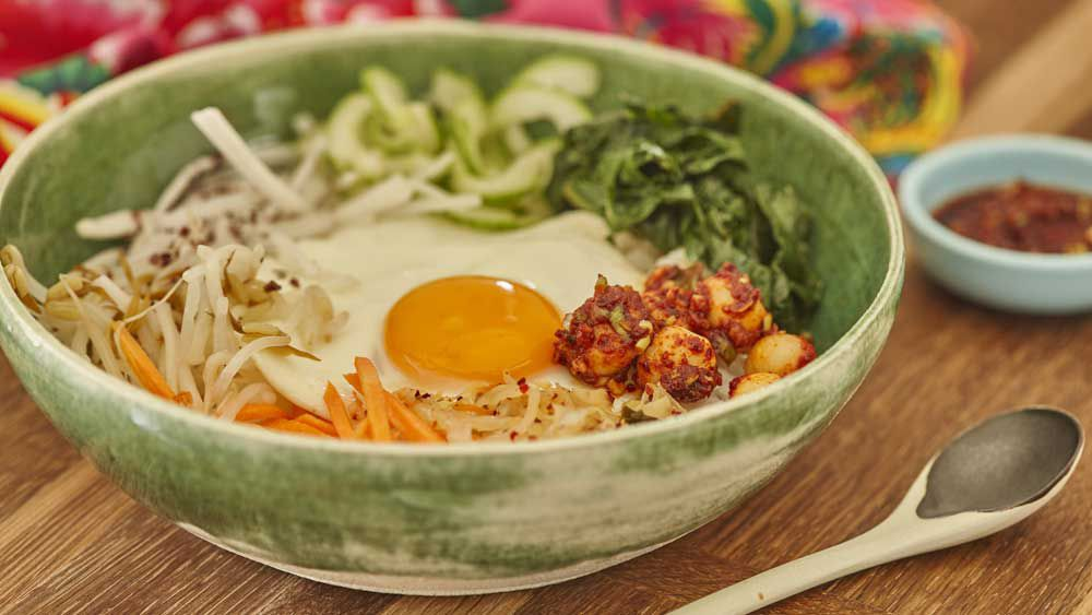Korean bibimbap with macadamia gochujang sauce and spicy macadamias