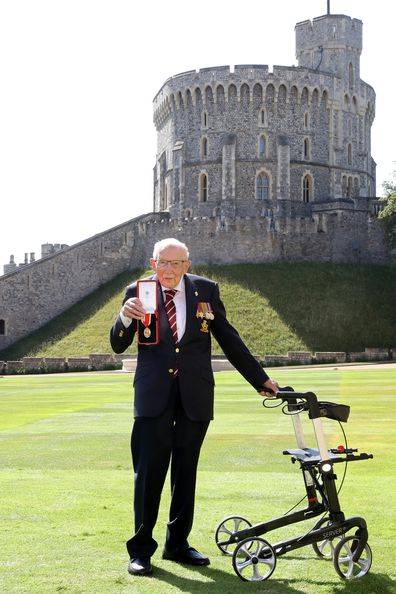 Captain Sir Thomas Moore poses after being awarded with the insignia of Knight Bachelor by Queen Elizabeth II at Windsor Castle on July 17, 2020 in Windsor, England. (Photo by Chris Jackson/Getty Images)