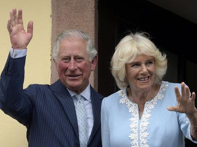 Britain's Prince Charles and Camilla, Duchess of Cornwall wave from the town hall balcony in Leipzig, Germany in 2019.