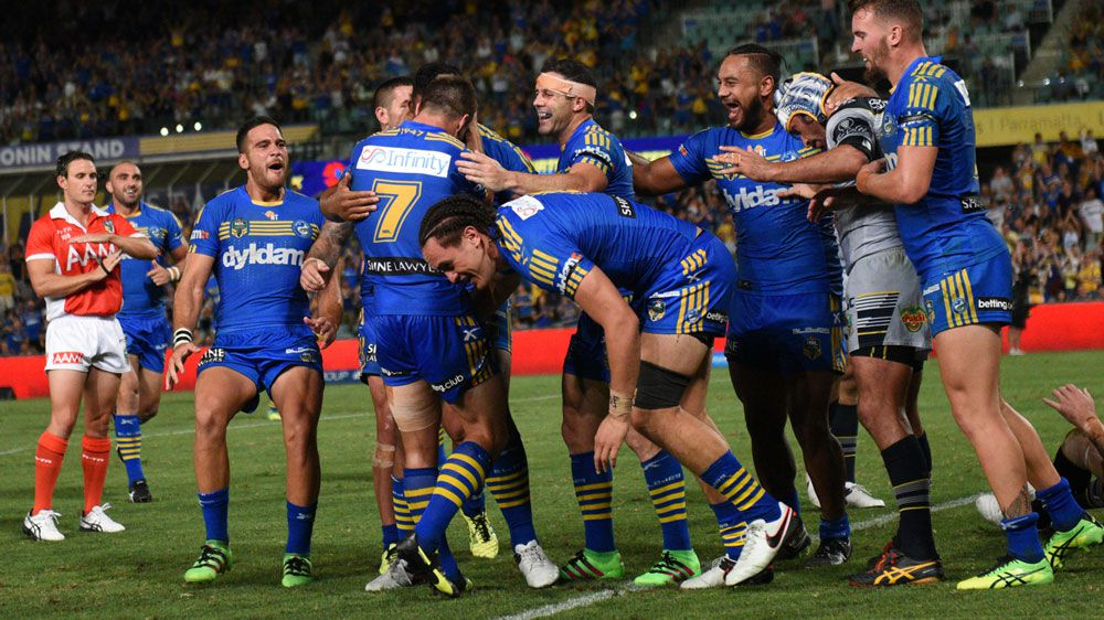 Eels players celebrate a try against the Cowboys. (AAP)