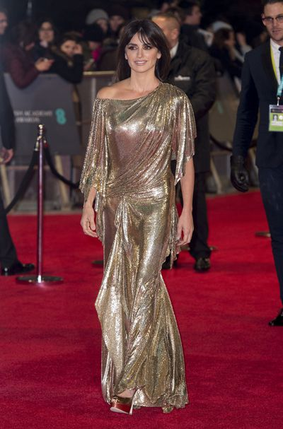 Penelope Cruz shimmered in 70's inspired gold.