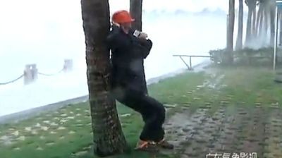A Chinese news crew eager to give viewers an eyewitness account of a tornado asked a reporter to put his life on the line by tying himself to tree to describe the chaos as it unfolded around him. Click through to see more videos of reporters in harm's way.
