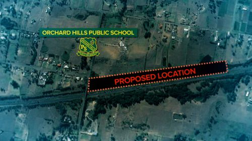 Parents are furious at the plan to bury it just 160 metres from Orchard Hills Public School.
