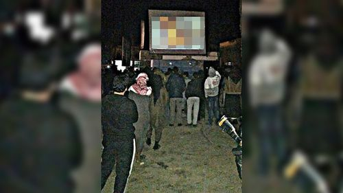 Yusuf Yusuf joined a crowd in Raqqa to watch a public screening of the death of Jordanian pilot Moaz al-Kasasbeh. (Facebook)