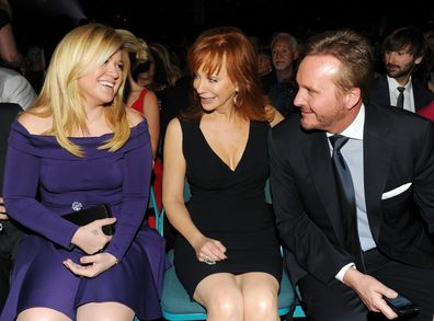 Singers Kelly Clarkson and Reba McEntire and Narvel Blackstock during the 48th Annual Academy of Country Music Awards at the MGM Grand Garden Arena on April 7, 2013 in Las Vegas, Nevada.