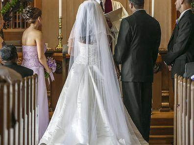 Bride and groom standing at altar during wedding ceremony divorce