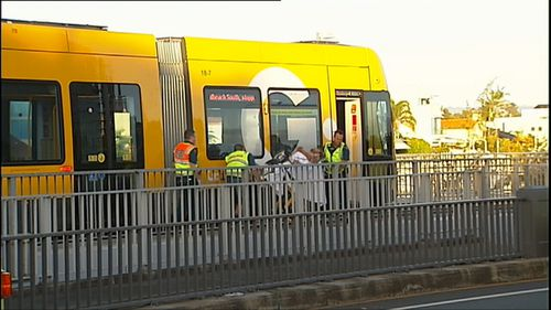 The man's legs were trapped beneath the tram after it ran over him. (9NEWS)