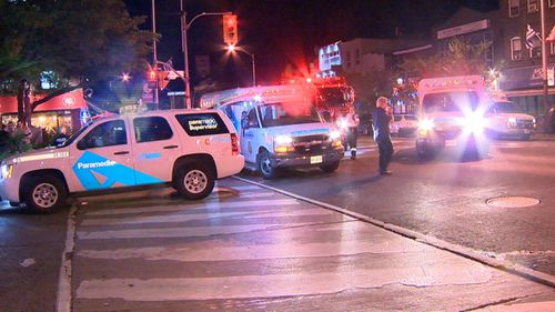 Police and paramedics attend victims at the scene of the alleged shooting. Picture: JeremyGlobalTV