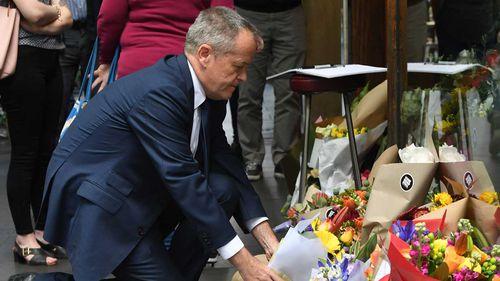 Opposition Leader Bill Shorten leaves flowers at a makeshift memorial for Sisto Malaspina.