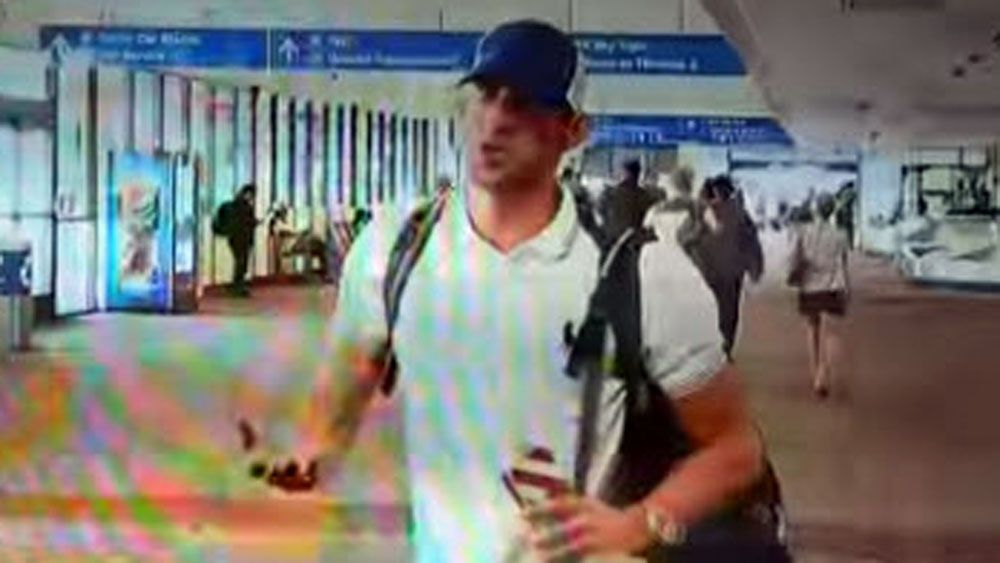Phelps rudely sweeps aside reporter after landing in US