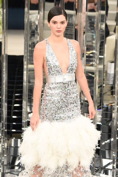 Kendall Jenner in a sequinned, feathered dress capped with a metallic silver belt for Chanel - Paris Haute Couture Spring Summer 2017.