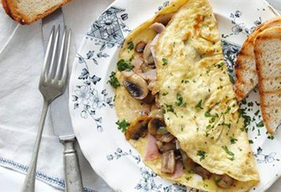 Fluffy cheese and mushroom omelette