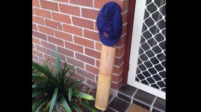"<p>A Sydney father has sparked a viral tribute to late Australian cricketer Phillip Hughes by placing his cricket bat at his front door and tweeting the image with the hashtag #putoutyourbats.</p><p>  As the news of Hughes' death spread across the internet, Paul Taylor placed his cricket bat at his front door as ""a mark of respect"".</p><p>  The commemoration has since gone global, with grieving cricket fans from Wellington to London joining in. </p><p>  Australian Olympic cycling champion Anna Meares, former England captain Michael Vaughan and former Australian cricketer Dean Jones have also tweeted putting out their bats. </p><p>  Phillip Hughes, 25, died on Thursday afternoon in St Vincent's Hospital in Sydney having failed to regain consciousness after being struck by the ball when batting for South Australia against New South Wales at the Sydney Cricket Ground on Tuesday. </p><p>  The blow caused Hughes to suffer a ""vertebral artery dissection"", an injury described by Australian team doctor Peter Brukner as ""extremely rare"". </p><p>  @Squizabilly</p><p>  #RIPPhillipHughes #putoutyourbats</p><p></p>"