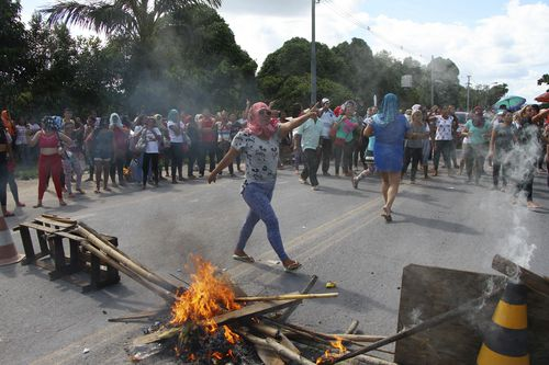 Relatives protest for more information, outside the Anisio Jobim Prison Complex where a deadly riot erupted among inmates in the northern state of Amazonas, Brazil.
