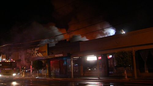 An abandoned Foodworks supermarket was found alight and billowing plumes of smoke. (9NEWS)