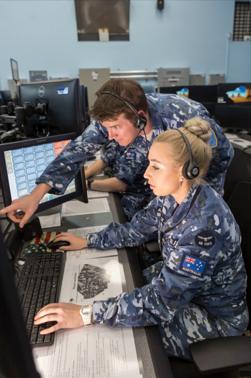 Flight Lieutenat Michael Pickering, an Air Warfare Instructor, and Flying Officer Stephanie Geaney, an Air Battle Manager. The RAAF ran the control and reporting centre for the whole exercise. (9NEWS)