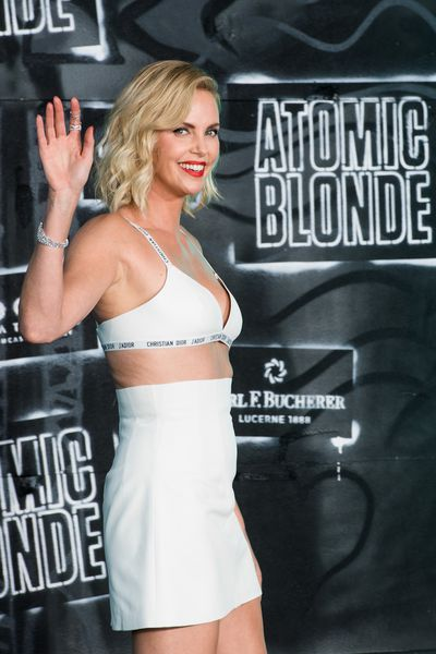 Charlize Theron attends the <em>Atomic Blonde</em> world premiere in Berlin in Dior on July 17.