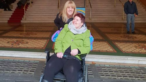 Sarah on an outing with a family friend. Sadly her excursions from the nursing home have now been cut due to a lack of funding.
