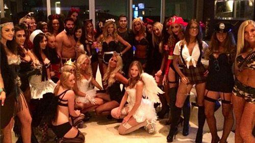 Dan Bilzerian among a group of scantily clad ladies. (Instagram)